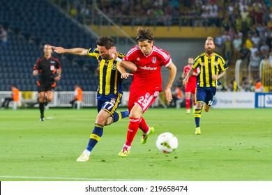 ISTANBUL - AUGUST 08, 2014: Ugur Boral is attacking to Fenerbahce in Soma Charity Tournament in Sukru Saracoglu Stadium.