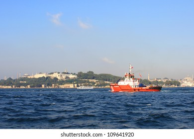 ISTANBUL - AUGUST 6: A firefighter ship convoys the oil products tanker MINERVA on August 6, 2012 in Istanbul. Usually the captain of the pilot ship takes the control during the passing of Bosphorus.