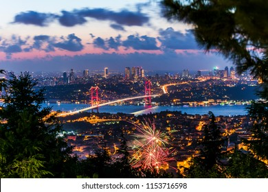 Istanbul Bosphorus Bridge with Fireworks. 15th July Martyrs Bridge. Night view from Camlica Hill. Istanbul, Turkey.