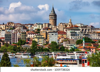 Istanbul city skyline with Galata Tower, tour boats and ferries on Golden Horn, Beyoglu district, Turkey