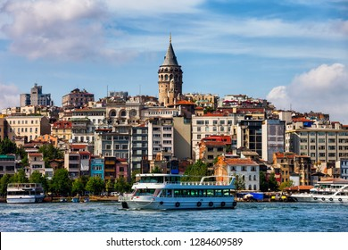 Istanbul city skyline with Galata Tower in Turkey, Beyoglu district cityscape, ferryboat cruise on the Golden Horn.