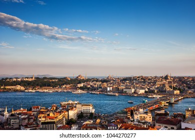 Istanbul city at sunset in Turkey, Sultanahmet and Eminonu districts seen from Beyoglu and Galata Bridge on Golden Horn.