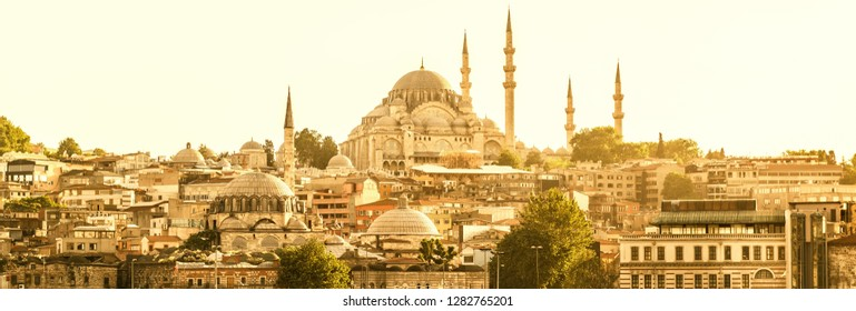 Istanbul cityscape in sunlight, Turkey. Panoramic sunny view of Istanbul and Suleymaniye Mosque in center. Horizontal banner with old buildings of Istanbul. Ottoman architecture of Istanbul in summer.