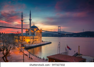 Istanbul. Image of Ortakoy Mosque with Bosphorus Bridge in Istanbul during beautiful sunrise.