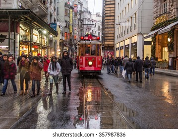 ISTANBUL - JANUARY 3 : Taksim Istiklal Street at eventide on January 3, 2016 in Istanbul, Turkey. Taksim Istiklal Street is a popular tourist destination in Istanbul after snow there are reflections.