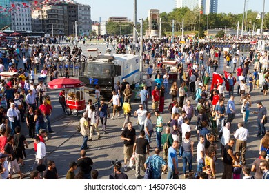 ISTANBUL - JULY 06: Police forces start interfere to protests in Taksim Square on July 06, 2013 in Istanbul, Turkey. People are protesting the prohibition of entry to Gezi Park since 15 June 2013