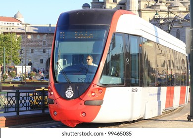 ISTANBUL - JULY 22: A modern tram on Galata Bridge on July 22, 2011 in Istanbul. Due to increasing traffic & air pollution, Istanbul became one of most polluted city also planned for return of tram.
