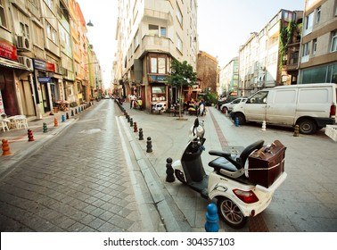 ISTANBUL - JULY 23: Old motorbike standing between historical buildings of district Kadkoy at sunny morning on July 23, 2015. With popul. of 14.4 million, Istanbul is the 5th largest city in world