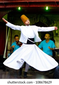 ISTANBUL - JULY 25: Sufi whirling dervish (Semazen) dances at Sultanahmet during month of Ramadan on July 25, 2012 in Istanbul. Semazen conveys God's spiritual gift to those are witnessing the ritual.