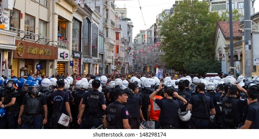 ISTANBUL - JULY 31: Police forces intervene people in Taksim on July 31, 2013 in Istanbul, Turkey. People gathered and protest for Berkin Elvan who was shot in the head with a tear gas canister.