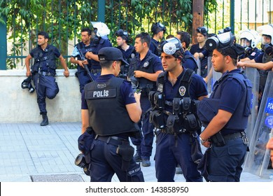 ISTANBUL - JUN 17: Five labor unions call 1-day nationwide strike over crackdown on June 17, 2013 in Istanbul, Turkey. Police wearing full equipment belt wait against demonstrators on Istiklal Street