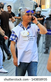ISTANBUL - JUN 17: Labor unions call 1-day nationwide strike over crackdown on June 17, 2013 in Istanbul, Turkey. Human rights member wearing white shirt, monitors possible abuses during demonstration