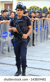 ISTANBUL - JUN 17: Labor unions call nationwide strike over crackdown on June 17, 2013 in Istanbul, Turkey. Police wait in full riot gear on Istiklal Street to prevent people march to Taksim Square.