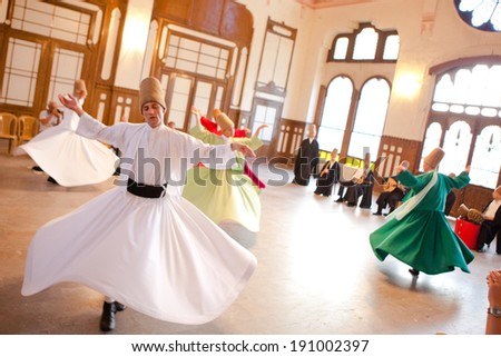 ISTANBUL - JUNE 18: Whirling Dervishes perform a sacred mevlana dance at Serkeci Train Station on June 18, 2011 in Istanbul, Turkey.