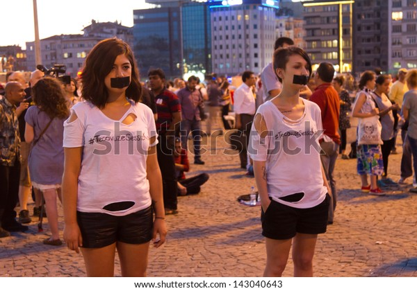 ISTANBUL - JUNE 19: Girls make silent protest in Taksim on June 19, 2013 in Istanbul, Turkey. After evacuation and occupation Gezi Park by police, people started silent demonstration in Turkey
