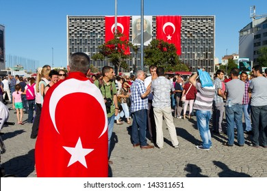ISTANBUL - JUNE 22: People make silent protest in Taksim on June 22, 2013 in Istanbul, Turkey. After evacuation and occupation Gezi Park by police, people started silent demonstration in Turkey