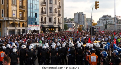 ISTANBUL - JUNE 29: Police force around Taksim Square during protests in Turkey on June 29, 2013 in Istanbul, Turkey. Gezi Park protests developed into anti-government demonstrations.