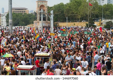 ISTANBUL - JUNE 30: People in Taksim Square for LGBT pride parade on June 30, 2013 in Istanbul, Turkey. Almost 100.000 people attracted to pride parade and the biggest pride ever held in Turkey.