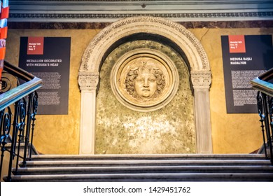 ISTANBUL - JUNE 5, 2019: Istanbul Archaeology Museum interior view Closeup of Medusa's head carved on the stone face Istanbul City of Turkey.