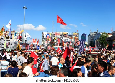 ISTANBUL - JUNE 9: People are at Taksim Square to protest against replacing Taksim Gezi Park on June 9, 2013 in Istanbul, Turkey. Protests developed into antigovernment demonstrations.