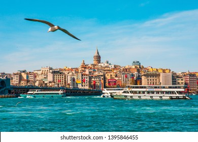 Istanbul, Karakoy / Turkey - 25-04-2019 :  Galata Tower in istanbul City of Turkey.  View of the Istanbul City of Turkey with bosphorus, seagulls and boats.