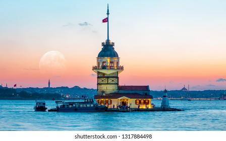 Istanbul Maiden Tower (kiz kulesi) with full moon - Istanbul, Turkey