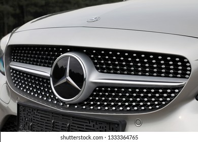 ISTANBUL - MARCH 09, 2019 : Mercedes-Benz C200 AMG 4Matic brand logo close-up. C-Class is a line of compact executive cars produced by Daimler AG.