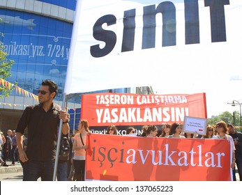 ISTANBUL - MAY 1: Many people can't take part in May Day march on May 1, 2013 in Istanbul. Police blocked all the ways to Taksim Square to prevent activists from joining their mates. Lawyers protest