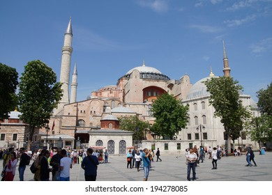ISTANBUL - May 13, 2014 - Tourists gather in front of Hagia Sophia ( Ayasofya ) dome and minarets , 6th century Byzantine cathedral then mosque in Istanbul, Turkey