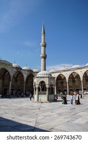 ISTANBUL - May 13, 2014 - Tourists viisit the octagonal sadirvan ( fountain ) in courtyard of  Sultan Ahmet Camii ( Blue Mosque ) in Istanbul, Turkey