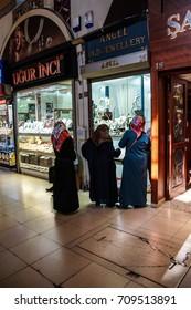 ISTANBUL - May 13, 2014 - Veiled women  shop in the Grand Bazaar (Kapali carsi ) in Istanbul, Turkey