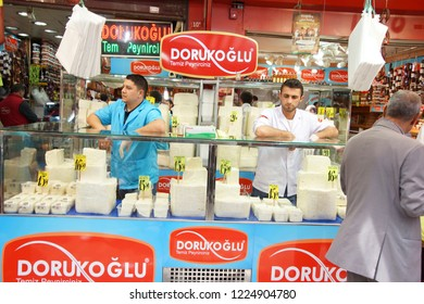 ISTANBUL - May 14, 2014 - Cheese vendors in their stall  in a Turkish bazaar  in Istanbul, Turkey