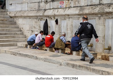 ISTANBUL - May 14, 2014 - Muslim men perform Ablutions before entering the mosque for noon prayers  in Istanbul, Turkey