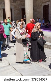 ISTANBUL - MAY 17, 2014 -  Veiled Turkish women move through the courtyard of the Blue Mosque after the call to prayer,  in Istanbul, Turkey