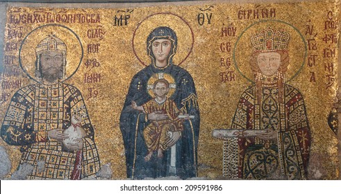 ISTANBUL - MAY 17, 2014 - Virgin Mary and infant Christ child, flanked by Emperor John Comnenus and Eirene Byzantine mosaic in the gallery of  Hagia Sophia  in Istanbul, Turkey