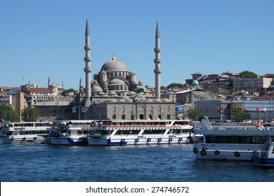 ISTANBUL - MAY 18, 2014 - Bosphorus ferry carries tourists and commuters across the Golden Horn, with the Yeni Camii mosque in background,  in Istanbul, Turkey
