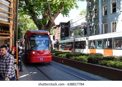 ISTANBUL - MAY 18, 2014 - Colorful tram rapid transit heads down to the Golden Horn  in Istanbul, Turkey
