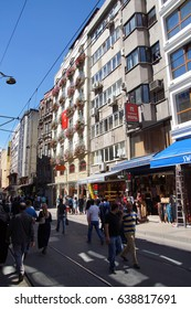 ISTANBUL - MAY 18, 2014 - Crowds walk on a residential street with apartment buildings, near  Topkapi Palace  in Istanbul, Turkey