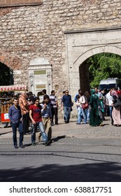 ISTANBUL - MAY 18, 2014 - Crowds walk on the shopping street outside Topkapi Palace  in Istanbul, Turkey