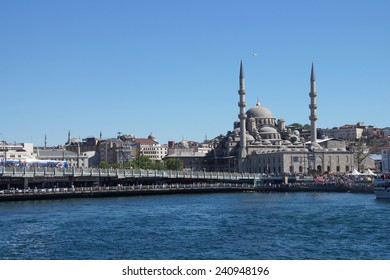 ISTANBUL - MAY 18, 2014 - Galata bridge and the Yeni Camii mosque on the Goldern Horn,  in Istanbul, Turkey