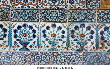 ISTANBUL - MAY 18, 2014 -   Iznik lapis  tiles with tulip pattern on a wall  Courtyard of the Favorites Harem of  Topkapi Palace, in Istanbul, Turkey