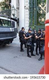ISTANBUL - MAY 18, 2014 - Police truck with water cannon and officers in riot gear await orders during a protest demonstration near Taksim Square  in Istanbul, Turkey