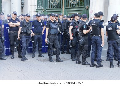 ISTANBUL - MAY 18, 2014 - Police in riot gear await orders during a protest demonstration near Taksim Square  in Istanbul, Turkey