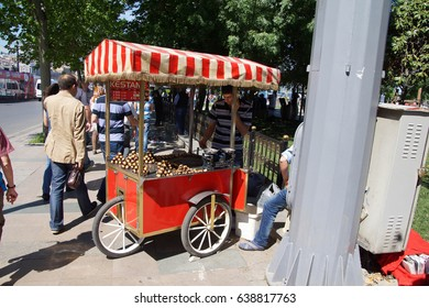 ISTANBUL - MAY 18, 2014 - Traditional hot chestnut vendor  in the bazaar  in Istanbul, Turkey