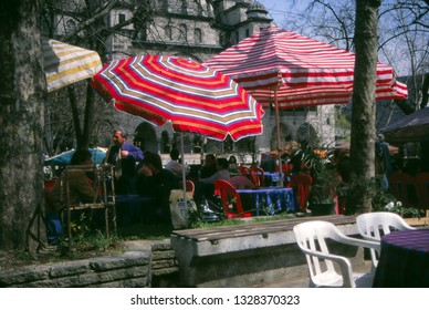 ISTANBUL - MAY 2, 2002 - cafe near Egyptian Market, with mosque in background,IstanbulTurkey