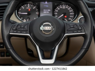 ISTANBUL - NOVEMBER 12, 2018 : Multimedia and crusie control controls on the steering wheel of the Nissan car.