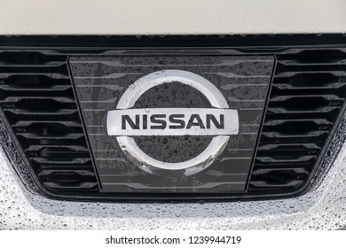 ISTANBUL - NOVEMBER 25, 2018: Close-up of rain drops on the fallen Nissan brand logo. Nissan is a Japanese multinational automobile manufacturer.