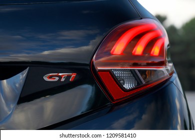 ISTANBUL - OCTOBER 12, 2018: Close-up of the GTI logo of the French car brand Peugeot. Peugeot, the French car, bicycle and motorcycle brand, today is part of PSA Peugeot Citroen.