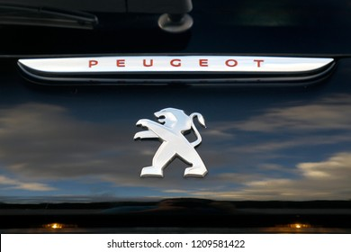 ISTANBUL - OCTOBER 12, 2018: Close-up lion logos of French car brand Peugeot. Peugeot, the French car, bicycle and motorcycle brand, today is part of PSA Peugeot Citroen.