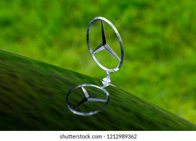 ISTANBUL, OCTOBER 2018: Mercedes Benz three-pointed star logo close up. Mercedes-Benz is a German automobile manufacturer. The brand is used for luxury automobiles, buses, coaches and trucks.